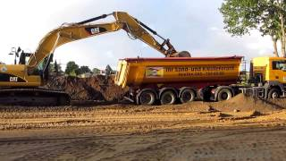 EXCAVATOR HELPING STUCK TRUCK ++ CAT 329D PUSHING DUMP TRUCK