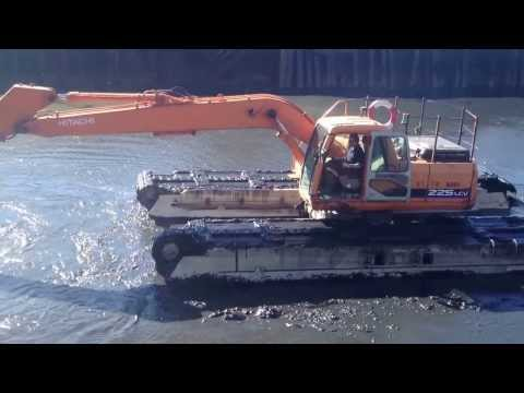 Floating digger .Dredging , disturbing the ragworms .