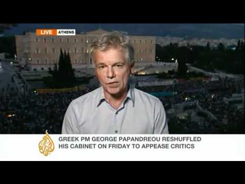 Greek PM addresses parliament as protest continues