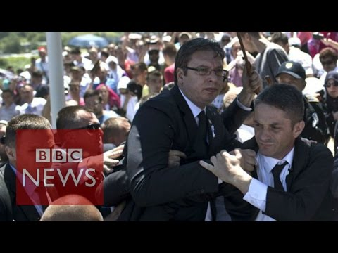 Srebrenica: Serb PM Vucic flees ceremony - BBC News