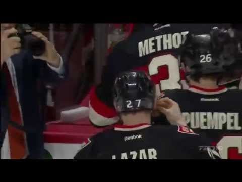 Curtis Lazar eats Hamburger thrown on ice !