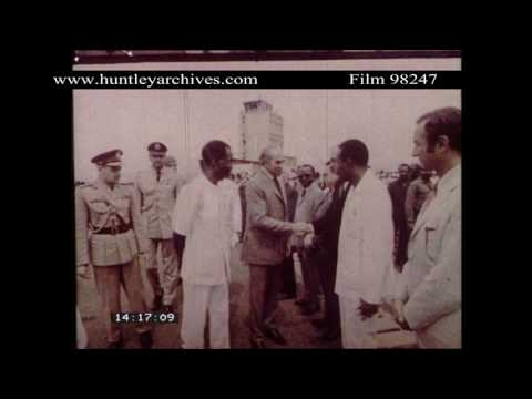 Guinean President Toure greets President Bhutto.  Archive film 98247