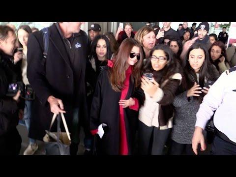 SELENA Gomez AGITATED ARRIVAL at Paris airport
