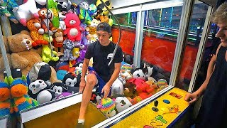 Sneaking into GIANT TOY CRANE MACHINE! *kicked out*