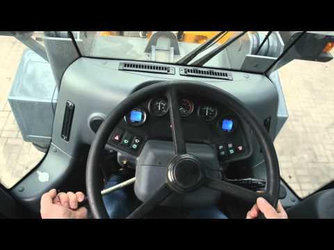Управление фронтальным погрузчиком: кнопочное, рычажное и