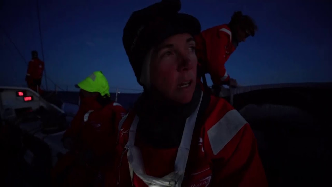 """Tack in the semi-darkness. Mark rounding. Someone (Annemieke?) counts down to the mark. Someone else shouts """"deploy, deploy, deploy..."""" TTToP behind them. Libby: We're just off the coast of Norway. Half a boatlength between us and Turn the Tide. But we did a better peel inside them, so we got better distance on them. Witty gives the owner instructions on the helm. TTToP a few boatlengths astern of them."""