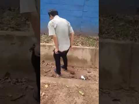 Chinese man caught defecating in a drainage in Lusaka's Longacres area
