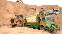 Cat 950B Wheel loader Loading Hino Dumper Truck