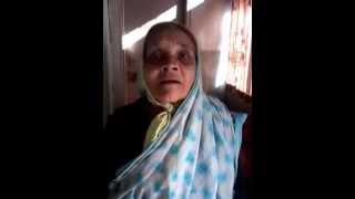 Old lady singing hindi song.Very funny...
