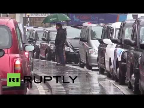 UK: Black cabs gridlock central London as fury against Uber and minicabs mount