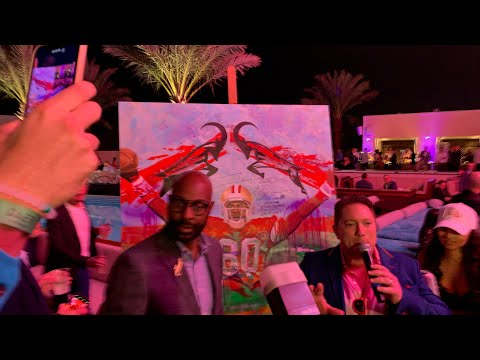 SF 49ers GOAT Jerry Rice Signs Painting At Culinary Kickoff Super Bowl LIV Party