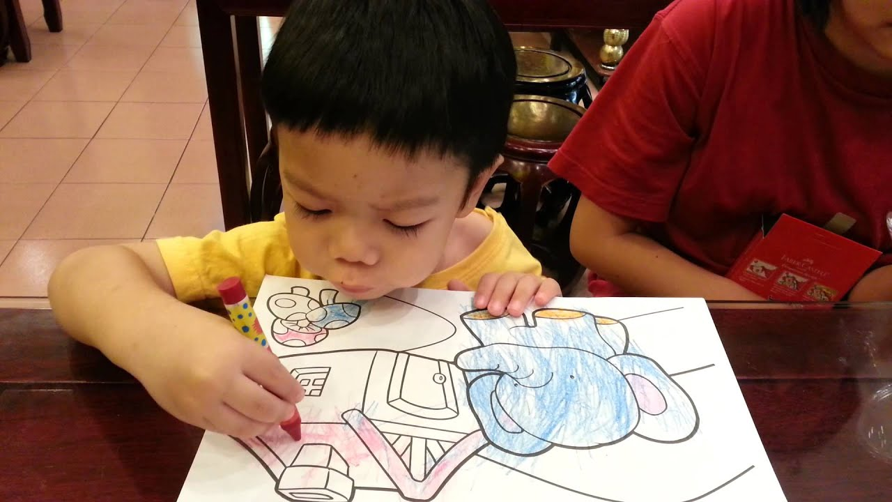 2 1 Year Old Toddler Colouring With Crayons