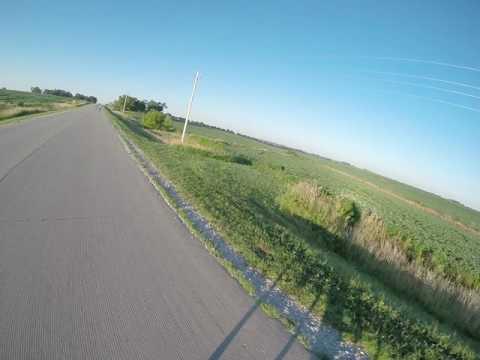 RAGBRAI day 3: Chasing my shadow on an early Iowa morning.