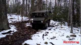 4X4 PINZGAUER TOURS DOWN STEEP HILL SNOW.wmv