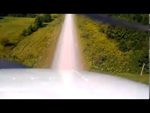 Airplane landing on narrow dirt road at Pictou Island