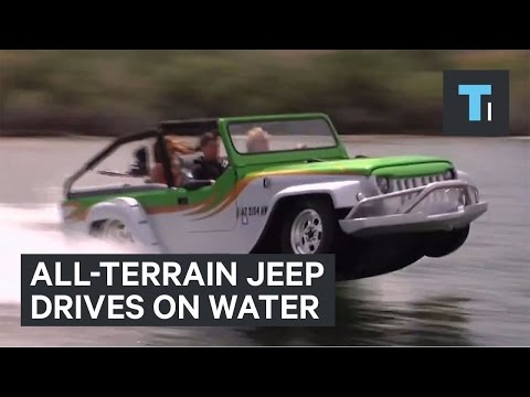 All-terrain jeep drives on water