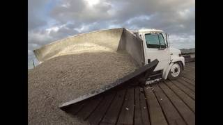 DUMP TRUCK FALLS THROUGH DOCK