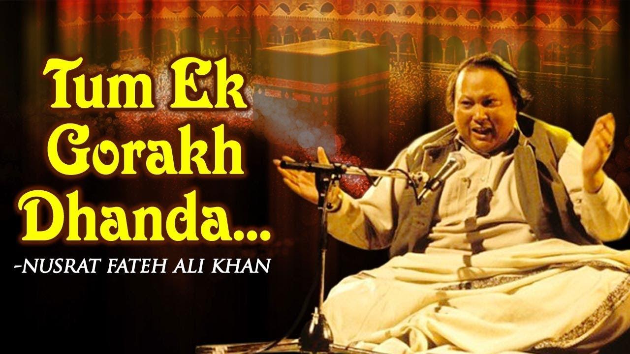 Tum Ek Gorakh Dhanda Ho by Nusrat Fateh Ali Khan with Lyrics — Popular Songs — Musical Maestros