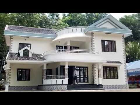 Beautiful house in kerala low cost homes youtube for Low cost home construction