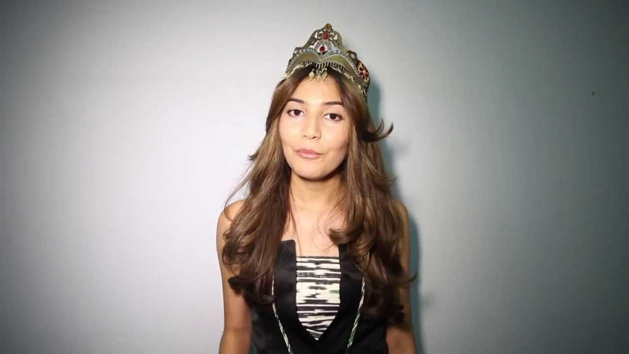 Tashkent, Uzbekistan. 17th Oct, 2014. A Miss Etiquette Reacts ...