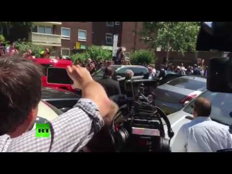 Theresa May heckled leaving Finsbury Park mosque