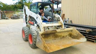 YOUNG AXEL AND DADDY DRIVE A SKID STEER