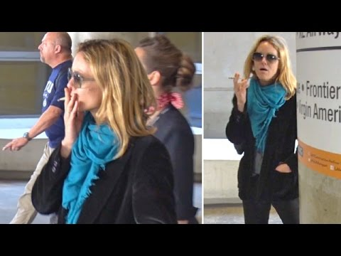 Vanessa Paradis Smokes A Cigarette After Touching Down At LAX Post-Cannes
