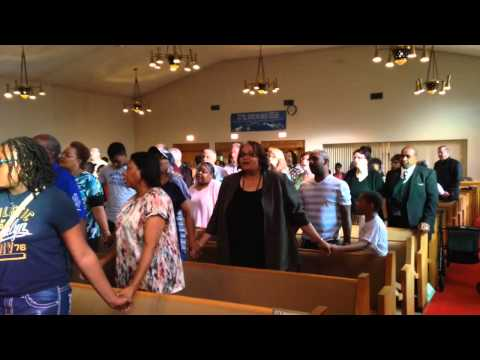 Watch Flint community sing 'We Shall Overcome' during prayer vigil