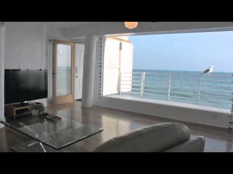 "Malibu ""Walls Of Glass On The Sand"" Oceanfront Vacation Rental"