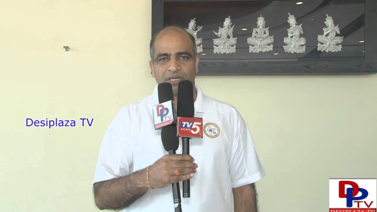 Dr.Sreenivas Gunukula, of IANT,Dallas speaking in Telugu to Desiplaza TV at Indian Consular Camp.