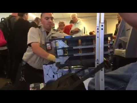 Guy puts a shitload of cash money in an ATM at busy LAX airport