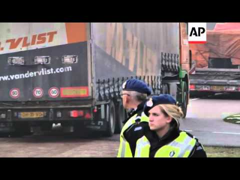 A convoy of  trucks carrying wreckage from the Malaysia Airlines Flight 17 disaster arrived at a Dut