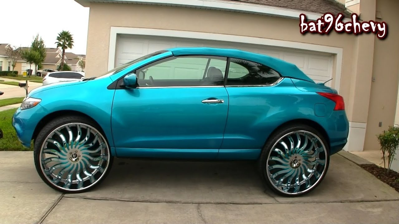 "female's candy teal nissan murano convertible on 32"" amani's"