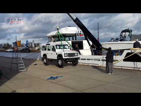 Hoisting a Land Rover Defender onto a Lynx Yacht