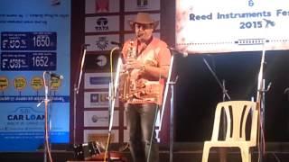 sj prasanna playing kannada song Ninnindale from milana on saxophone.