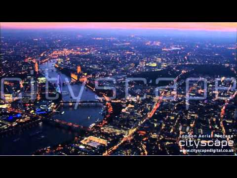 London Aerial Footage - Night time looking west over Parliament (HD)