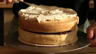 How To Assemble And Frost A White Cake With Raspberries