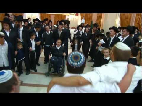 Hasidim dancing with disabled child