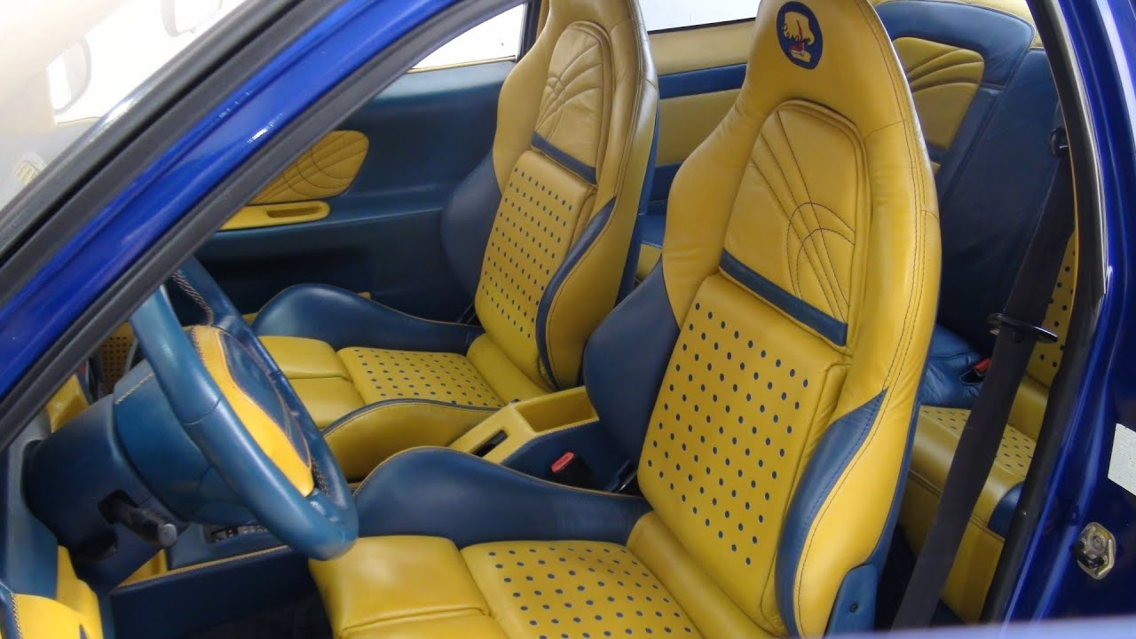 cost to reupholster car seats with leather