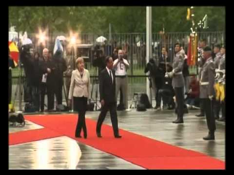 Angela Merkel barges François Hollande out of the way - shows who wears the trousers in EU
