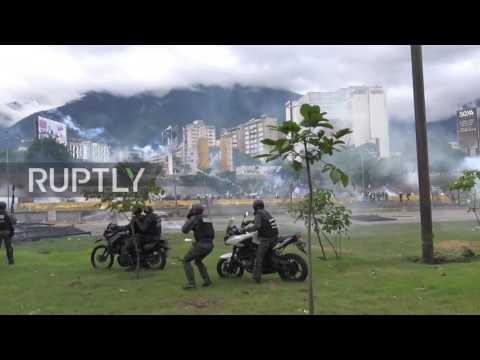 Venezuela: Police on motorbike battle protesters advancing on military base