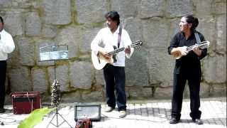 Aguas Calientes, Peru: Street musicians on guitar + charango