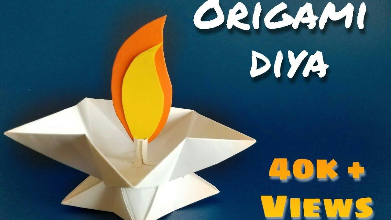 Origami diya diy paper candle star lamp diya paper for Diya decoration youtube