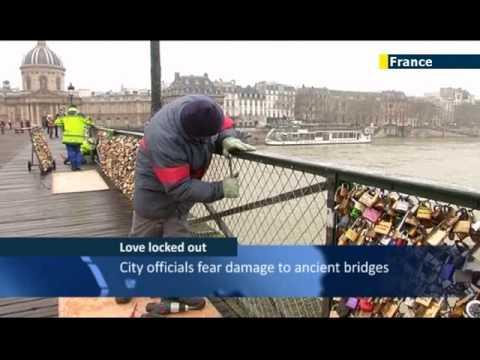 Passion for padlocks: Paris bridges popular with couples looking for romantic 'love' locks