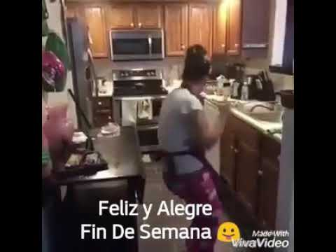 A crazy lady dancing to mexican music cleaning her house