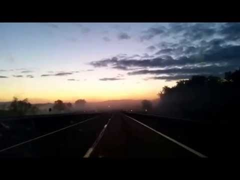 Sunrise and fog on a highway 20140824 054343