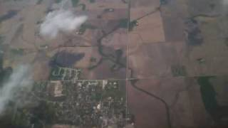 Aerial from Airplane over Colorado on Southwest looking over small farm towns