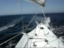 Proa JZERRO sailing past lighthouse