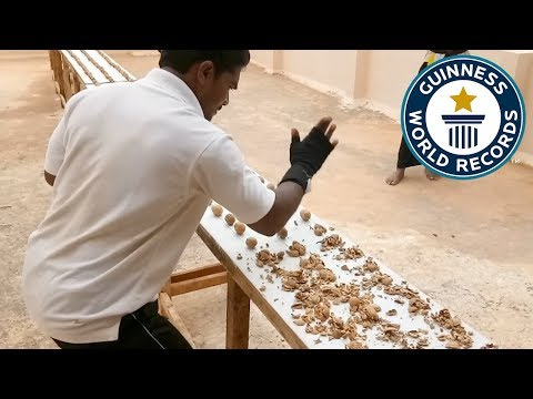 Most walnuts crushed by hand in one minute - Guinness World Records