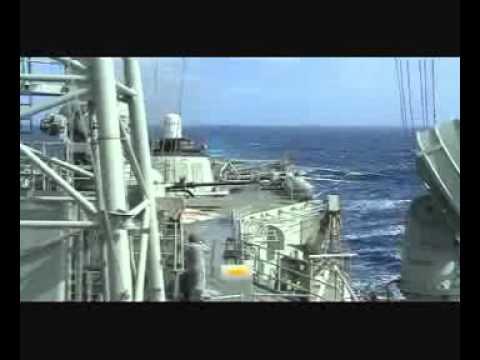 HMAS Canberra firing 80 round burst